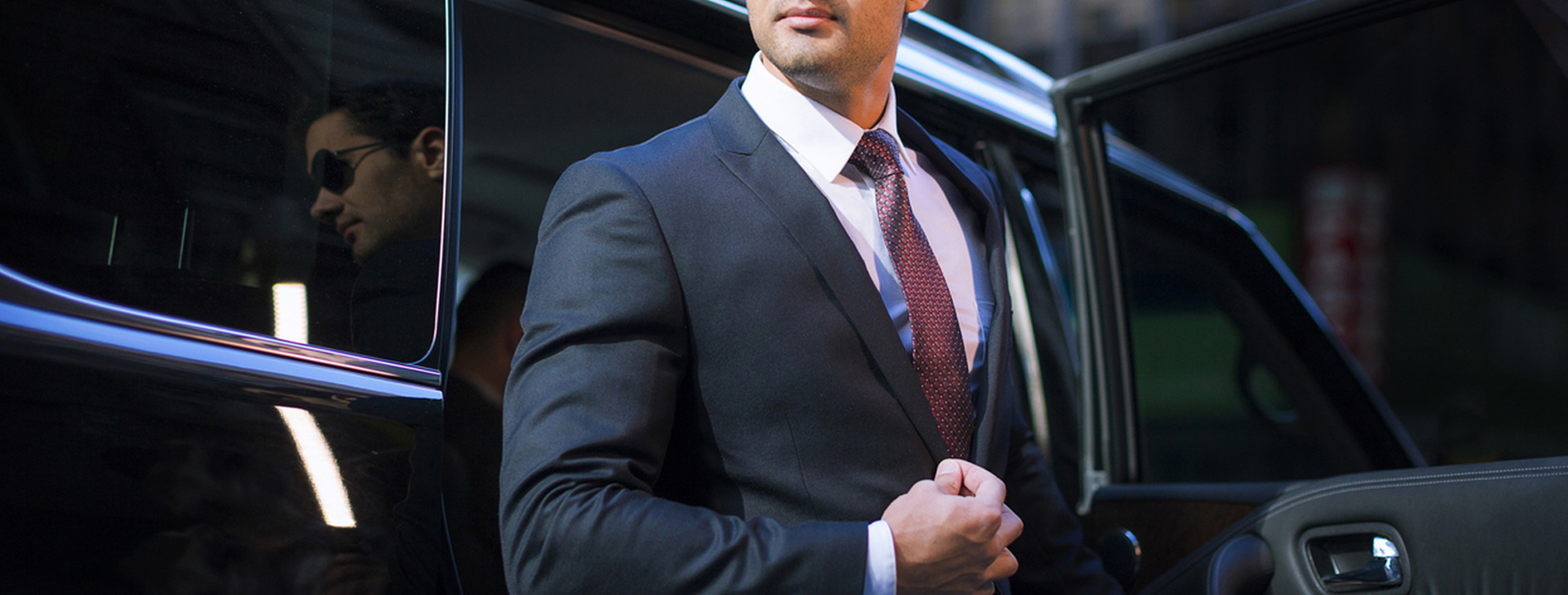 man in suit - prestige limousines